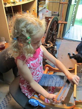 Child weaving scarf