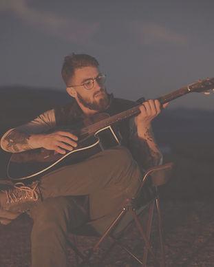 Man with Guitar_edited_edited_edited.jpg