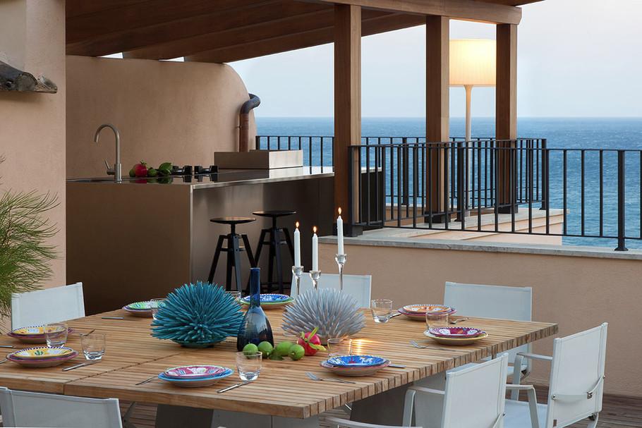 Ernesto Fusco Interiørarkitekt - Terrasse med utsikt over havet