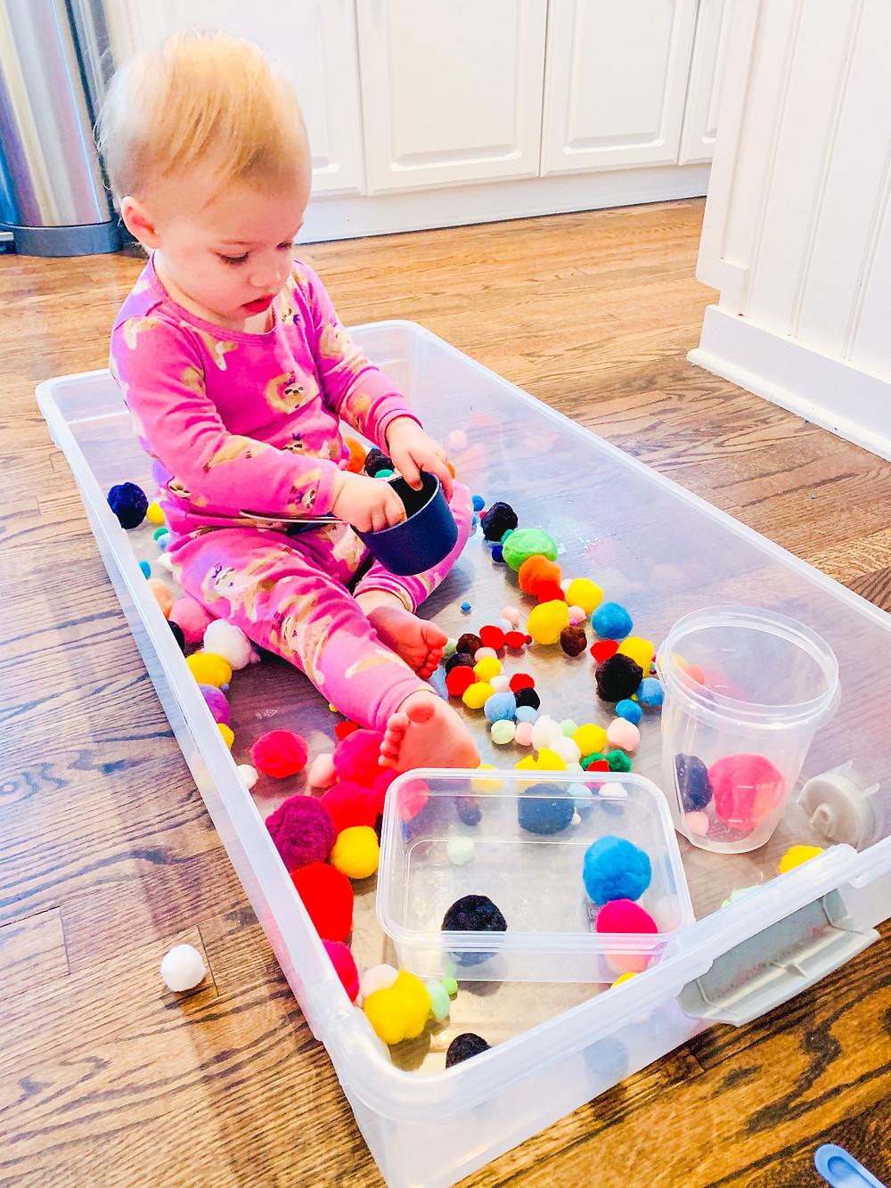 pom pom color sensory bin