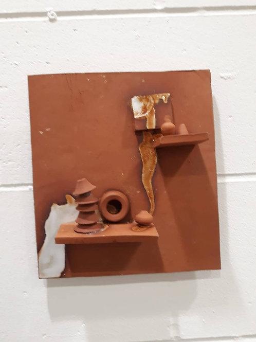 Wall mounted decorative artefact