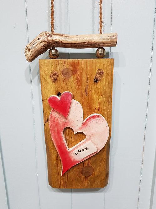 Double heart on wood