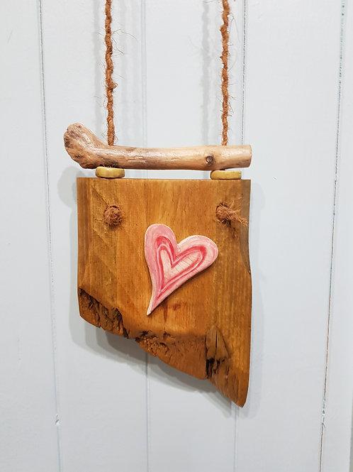 Single heart on wood