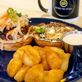 longanisa handheld with fried potatoes and smokey dip