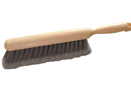 What is a grout brush for?