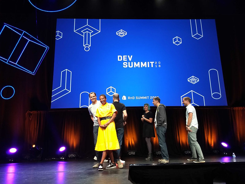 Anita on stage with coworkers at Shopify Dev Summit 2018