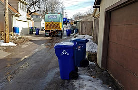 Eureka recycling truck driving down alley