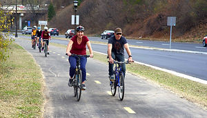 a group of bicyclists on the new Ayd Mill Road multi-use path