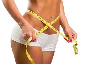 Image of woman measuring her waist representing weight loss.