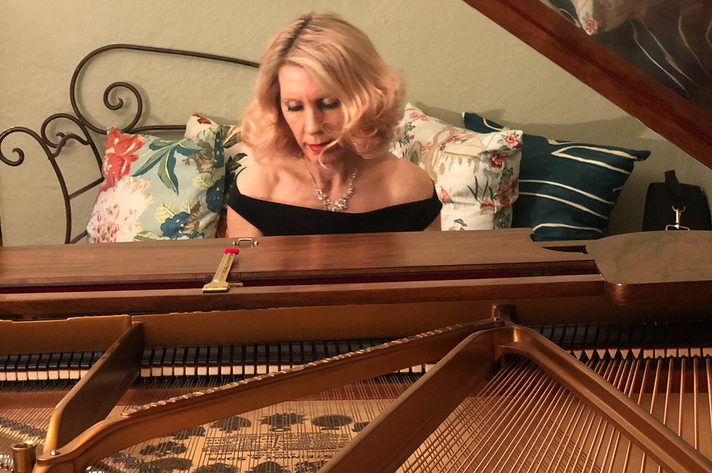 This is Lisa Niemeier performing at her steinway grand piano in her home. She studies with Thomas Pandolfi at M Institute for the Arts.
