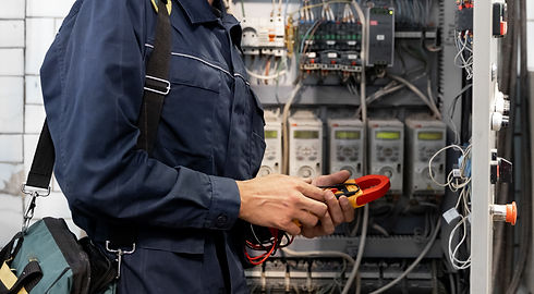 Electrician engineer checks electrical c