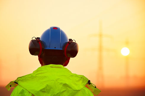 Worker is watching electricity pylons an