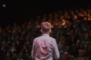 Speaker in front of a Crowd