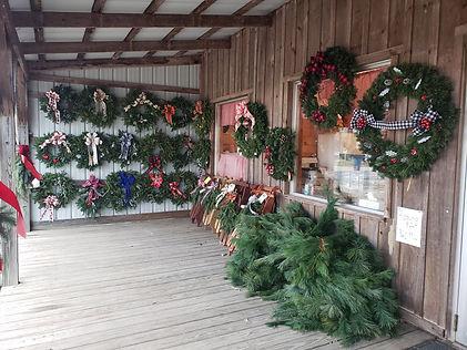 jordan wreathes.sleds.pine roping.jpg