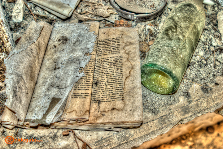 Old book and a cognac bottle in Theletra