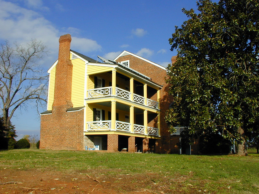 Repointed Brick with Fawn-Colored Mortar and Bright Yellow Siding highlight the exterior restoration