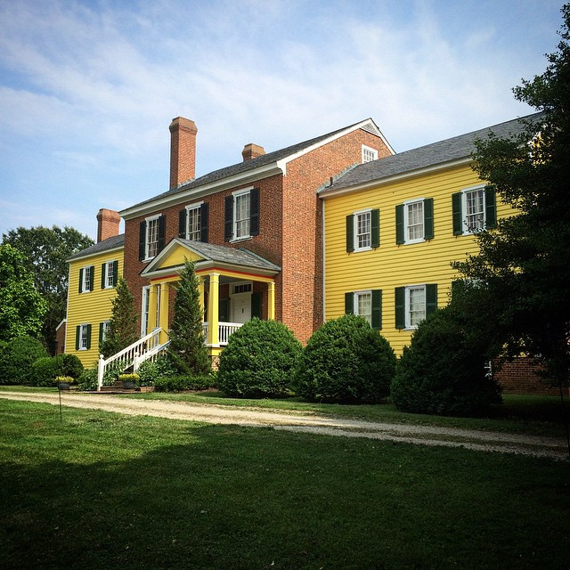 The Clover Forest Plantation Manor Home's Bright Yellow Clapboard