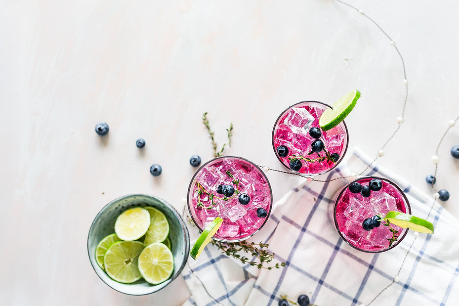 pink drink with lime and blueberries