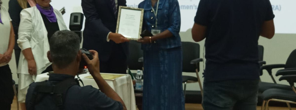 H. E. Hannah Nyarko being presented with a certificate for her participation, contributions and support for the  Gender Equality Conference.