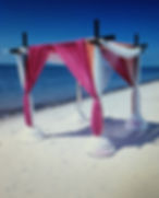 myrtle beach  weddings look so beautiful decorated with bamboo arch and pink and coral decor