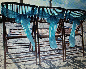 myrtle beach  wedding chairs with blue sashes