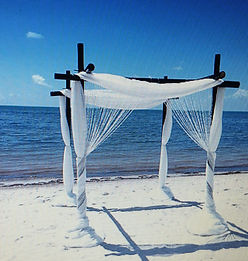 bamboo arch with white draping and crystals for myrtle beach weddings