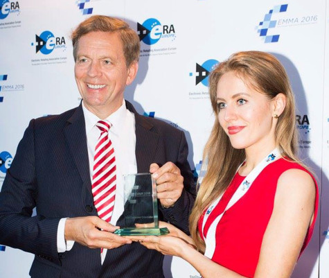 """Receiving the EMMA Award for """"BEST CONSUMER ORIENTED PRODUCT"""""""