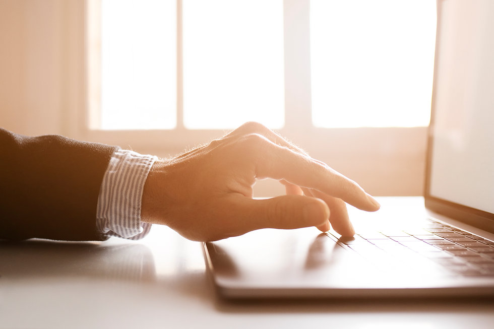 hands-of-a-businessman-using-laptop-on-t