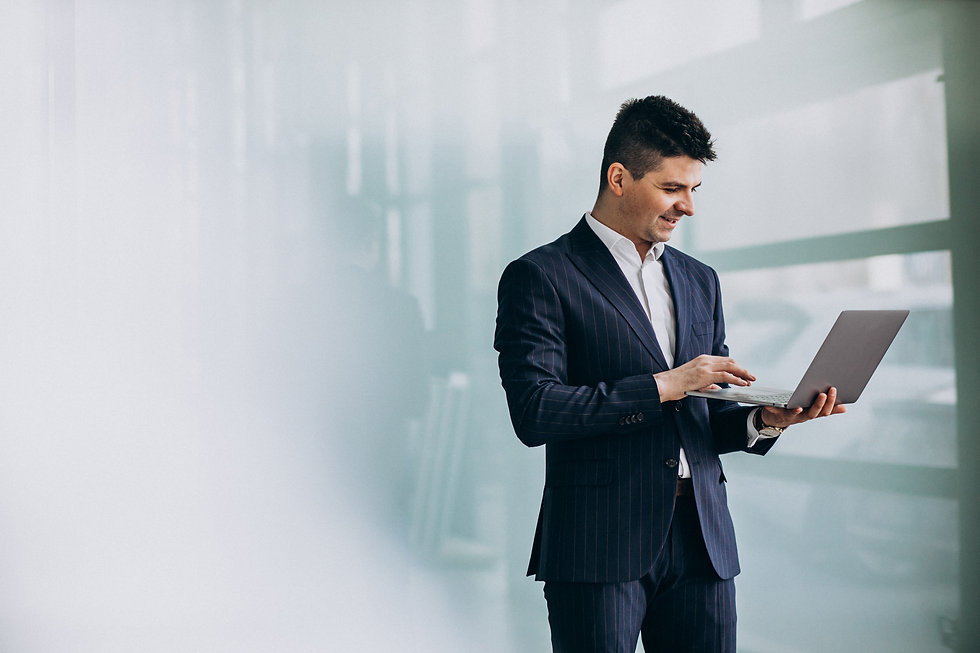 young-handsome-business-man-with-laptop-