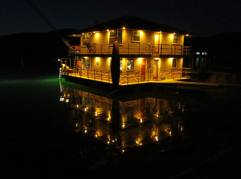 night shot of FloatHouse from a guest