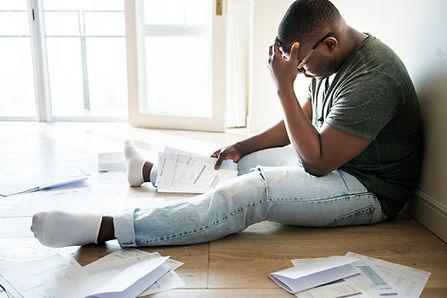 Man-managing-the-debt-937242074_3868x257
