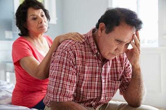 Wife-Comforting-Senior-Husband-Suffering