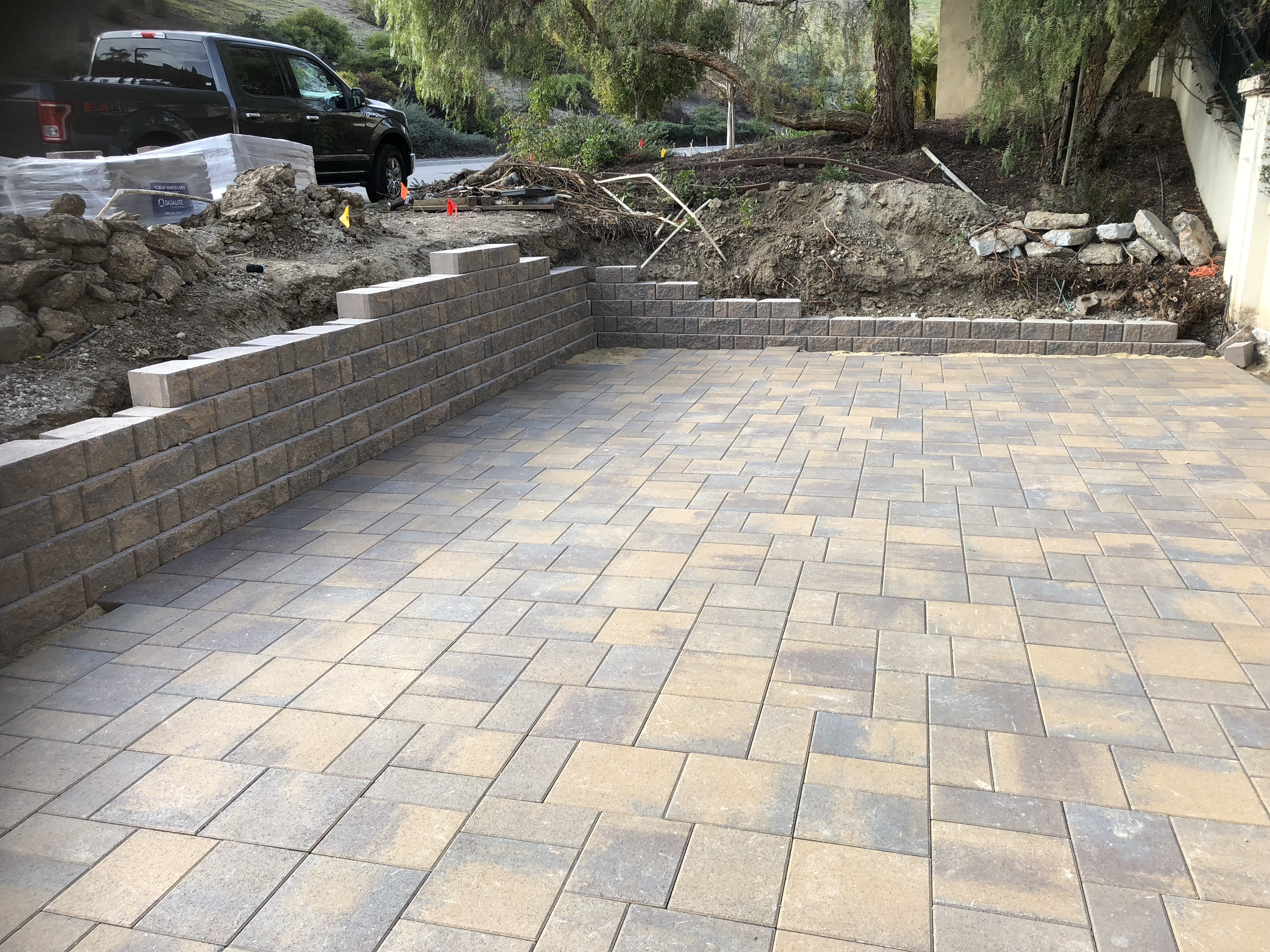 Block retaining wall and pavers