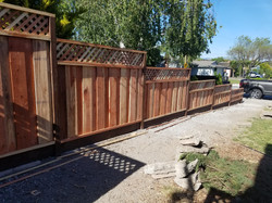 Stepping down fence with lattice