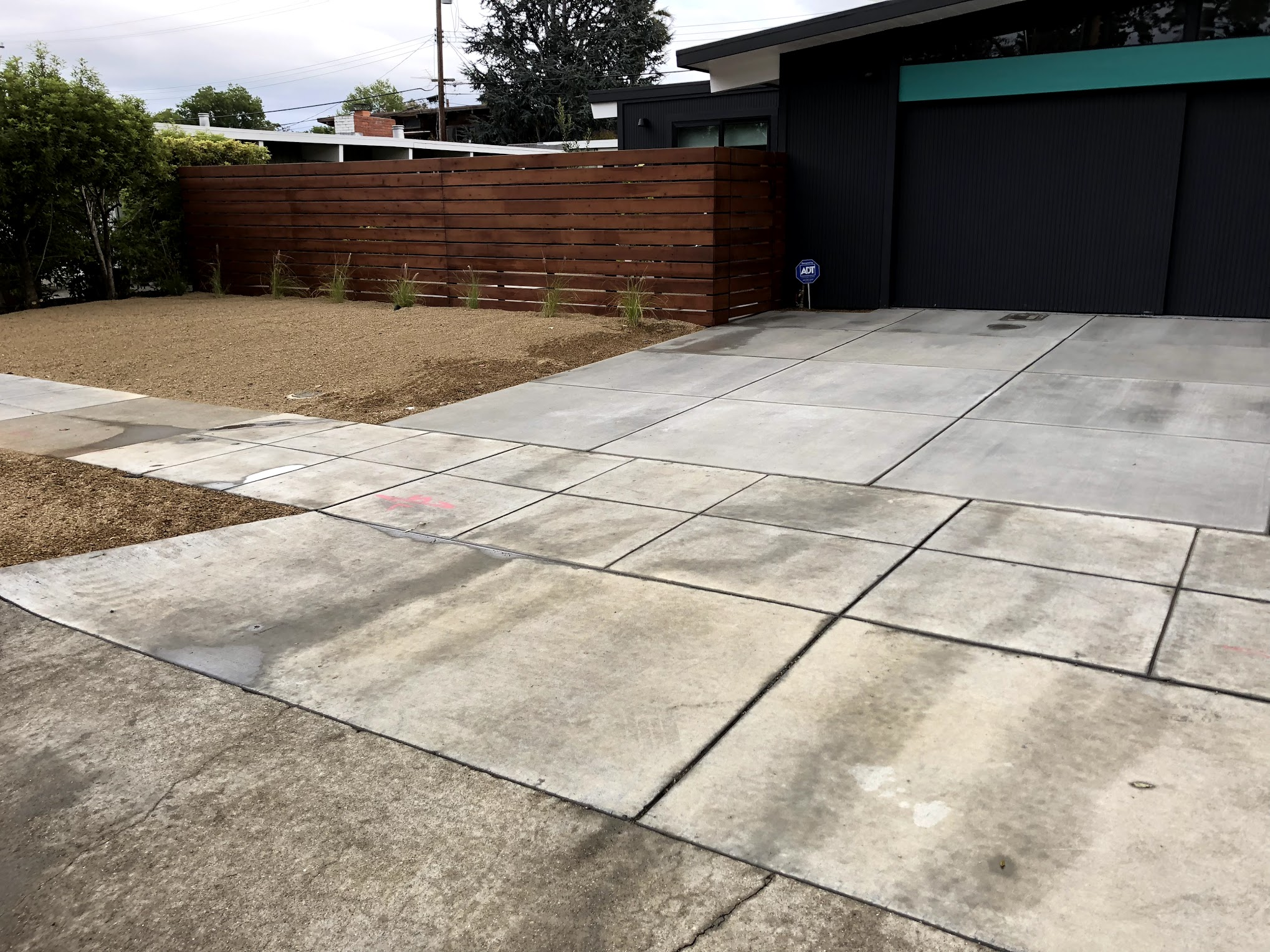 Custom fence, concrete and landscape