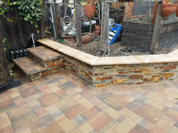 Paver and wall with cap