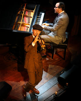Trumpet and Piano Player