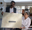 Sourav with his work.jpg