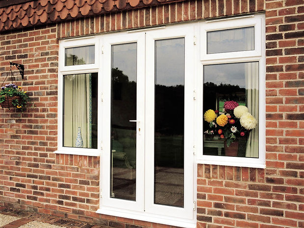 white uPVC (plastic) double doors with equal panels and safety glass