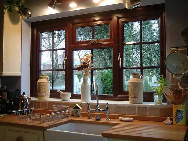 uPVC (plastic) standard casement window in brown colour