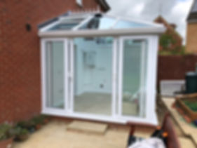 """white uPVC """"back to back"""" sliding on the inside tracks patio doors with two side glass panels"""