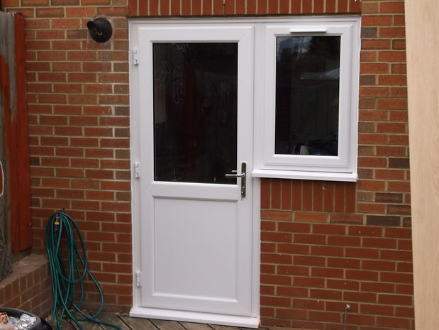 white uPVC (plastic) back door with a smooth bottom panel and clear glass top panel
