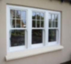 White uPVC (plastic) vertical sliding sash window with sash horns