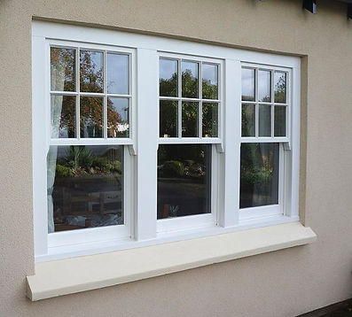 White uPVC (plastic) vertical sliding sash window with sash horns