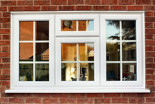 white uPVC window with Georgian bars