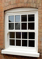 timber (wooden) traditional vertical sliding sash window with georgian bars