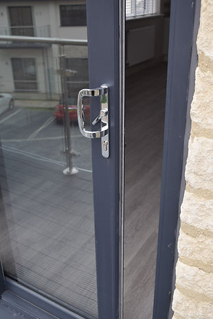 Anthracite grey patio door with modern silver coloured hardware