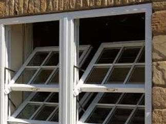 Vertical sliding sash windows with double tilt inward sashes