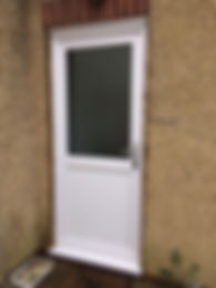 white upvc back door with an obscure glass top panel and smooth bottom panel