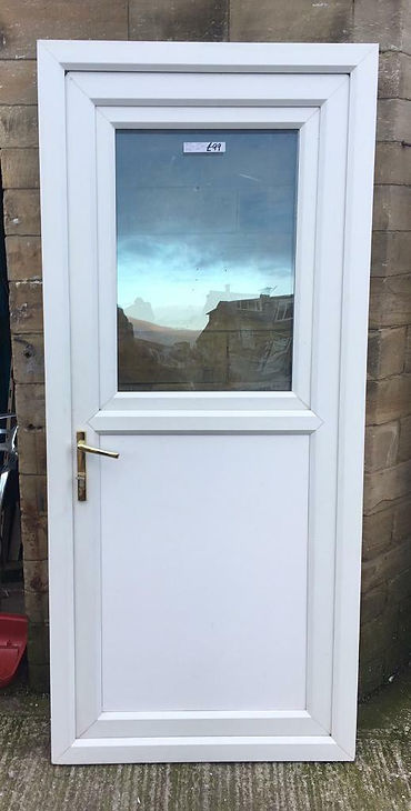 Tilt and turn white upvc door with a clear glass top panel